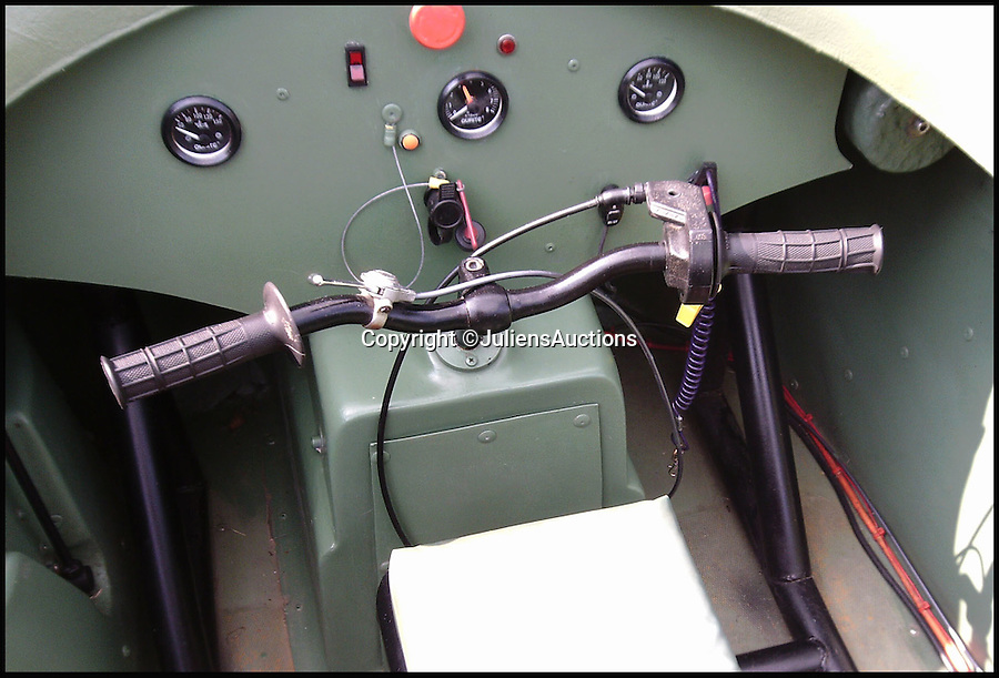 BNPS.co.uk (01202 558833)<br /> Pic: JuliensAuctions/BNPS<br /> <br /> ***Please Use Full Byline***<br /> <br /> The driving handlebars of the hovercraft that features in the James Bond film, Die Another Day. <br /> <br /> Est: £30,000<br /> <br /> The iconic micro-jet flown by Roger Moore in Octopussy and the swivel chair used by super-villain Blofeld are among a host of props from James Bond movies coming up for sale.<br /> <br /> The 12ft long BD-5J red, white and blue aircraft, that is the world's lightest jet, was piloted by 007 in the opening scenes of Octopussy, outwitting his Cuban captors.<br /> <br /> The aircraft was actually built seven years before the film as part of an air display team and was hired for the 1983 Bond flick.