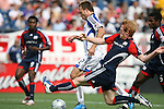 11 July 2009: New England's Pat Phelan (right) tries to tackle the ball away from Kansas City's Michael Harrington (2). The New England Revolution played the Kansas City Wizards at Gillette Stadium in Foxboro, Massachusetts in a regular season Major League Soccer game.