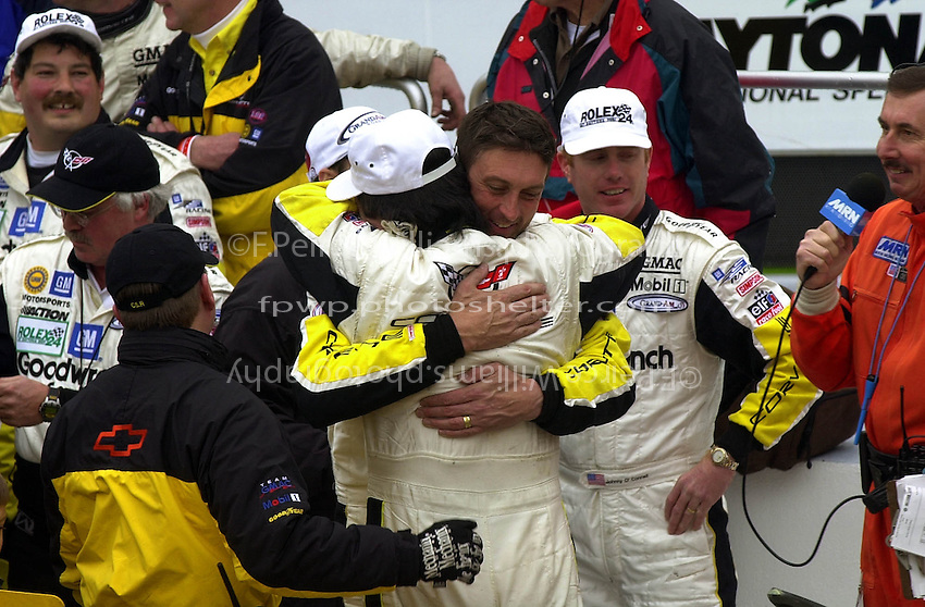 Ron Fellows receives a hug from long-time teammate Chris Kneifel in Victory Lane..39th Rolex 24 at Daytona, 3/4 February,2001 Daytona International Speedway  Daytona Beach,Florida,USA.©F.Peirce Williams 2001 ..