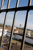South America, Argentina, La Plata, Los Olmos. Freedom Behind Bars, Prison and Divinity - A view of the yard in Unit 25 of Los Olmos Prison. Los Olmos Prison is one of the principal security prisons in Argentina. It hosts Unit 25, known as Christ the Only Hope Prison Church, one of the largest prison churches worldwide. The transformation of criminals into the God fearing and leading them to the Lord has taken hold, not only in the lives of inmates, but also in inmate families and prison guards. Once the countries worst killers and thieves have since become spiritual leaders to other criminals, creating a revolutionary spiritual rehabilitation, July 2006 &copy; Stephen Blake Farrington<br />