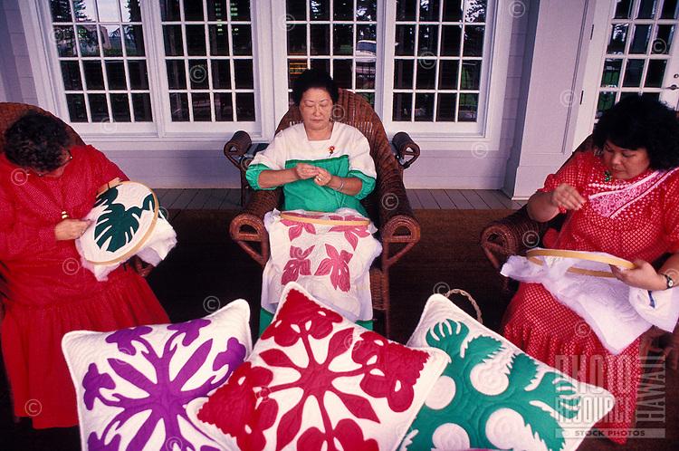 Three women quilting outside of Lanai's Koele lodge
