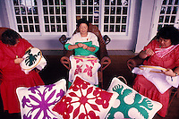 Three women quilting outside of Lanai's Koele lodge