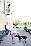 Debbie Quinn shares a hug with Bear outside of Roper Lanes and Lounge in Whitehall, Montana. The bar features a bowling alley from 1958...Whitehall's population was just over 1,000 in the 2000 census.