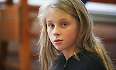 "Potrait of one of the girls in a drama group for 8-13s run by Yvonne Arnaud Theatre, rehearsing a production of ""Alice"" in a school hall, Guildford, Surrey."