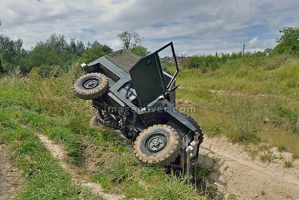 Land Rover Series 2a Lightweight on its side after it slipped off the track into a ditch while driving off road in Bining, France. --- No releases available. Automotive trademarks are the property of the trademark holder, authorization may be needed for some uses.