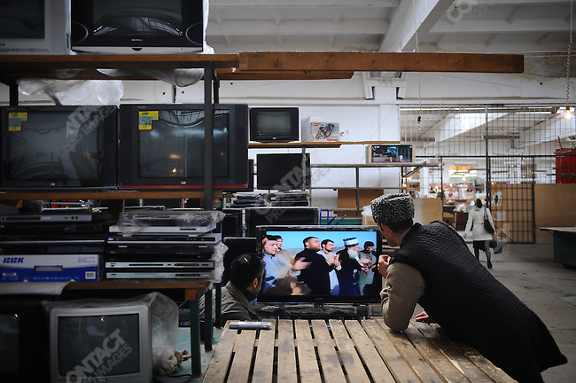 In the central market in Nazran, Ingushetia, at a tv vendors stand men watched a video of a visit of Chechen leader Ramzan Kadirov to Mecca. April 7, 2010