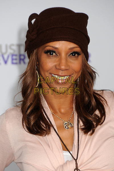 "HOLLY ROBINSON PEETE.""Justin Bieber: Never Say Never"" Los Angeles Premiere held at Nokia Theater L.A. Live, Los Angeles, California, USA..February 8th, 2011.headshot portrait necklace pink hat.CAP/ADM/BP.©Byron Purvis/AdMedia/Capital Pictures."
