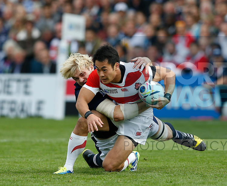 Ritchie Gray of Scotland  wraps up Kenki Fukuoka of Japan  - Rugby World Cup 2015 - Pool B - Scotland vs Japan - Kingsholm Stadium - Gloucester - England - 23rd September 2015 - Picture Simon Bellis/Sportimage