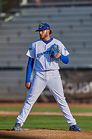 Ogden Raptors starting pitcher Juan Morillo (11) checks the runner against the Grand Junction Rockies at Lindquist Field on August 28, 2019 in Ogden, Utah. The Rockies defeated the Raptors 8-5. (Stephen Smith/Four Seam Images)