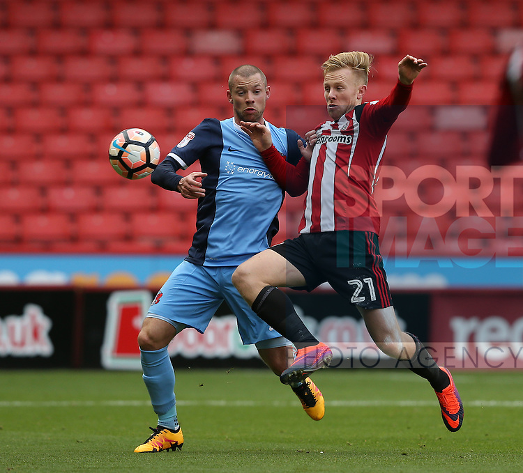 Mark Duffy of Sheffield Utd tussles Alan Dunne of Leyton Orient with during the Emirates FA Cup Round One match at Bramall Lane Stadium, Sheffield. Picture date: November 6th, 2016. Pic Simon Bellis/Sportimage