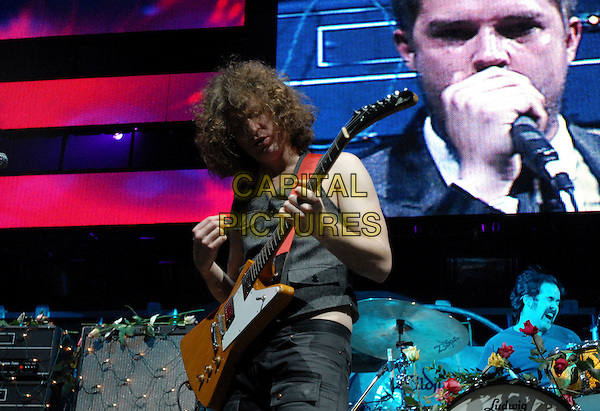 THE KILLERS.Live at Night one of The 106.7 KROQ Almost Acoustic Christmas held at The Gibson Ampitheatre in Universal City, California, USA. .December 10, 2006.stage concert gig performance music half length guitar.CAP/DVS.©Debbie VanStory/Capital Pictures