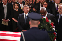 U.S. Supreme Court Chief Justice John Roberts looks over at Associate Justice Clarence Thomas, nominated to the Supreme Court by former President George H.W. Bush, as they stand before the late president's casket inside the U.S. Capitol Rotunda on Capitol Hill in Washington, U.S., December 3, 2018. <br /> CAP/MPI/RS<br /> &copy;RS/MPI/Capital Pictures