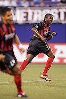 The  MetroStars' Fabian Taylor watches his shot find the back of the net as his teammate Amado Guevara celebrates. The Chicago Fire played the NY/NJ MetroStars to a one all tie at Giant's Stadium, East Rutherford, NJ, on May 15, 2004.