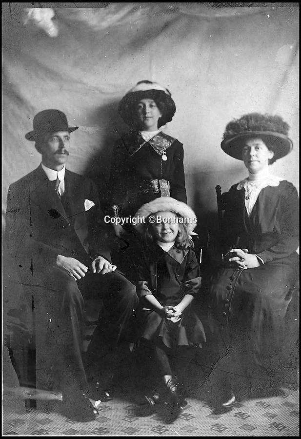 BNPS.co.uk (01202 558833)Pic: Bonhams/BNPS<br /> <br /> Winnie Barker(Bottom) with mother Martha Barker (right). Winnie was tragically killed when the Lusitania was sunk by the by the Germans.<br /> <br /> The tragic tale of a nine year old girl who was killed when the Lusitania was sunk by the Germans can be told after her mother's handbag emerged for sale 103 years later.<br /> <br /> Winnie Barker accompanied her mother Martha on the passenger liner which was en route from New York to Liverpool when it was torpedoed by a German U-boat on May 7, 1915, off Ireland.<br /> <br /> The pair were finishing lunch when the first torpedo struck and were stood on the deck for the fateful second blow.<br /> <br /> As the ship went down, they held hands and Winnie told her mother 'don't worry mother darling, we shall be saved'.<br /> <br /> Of the 1,962 passengers and crew members on board the Cunard liner, 1,201 were killed, including 159 Americans and three Germans held in the cells.