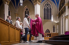 February 14, 2018; Rev. Pete McCormick, C.S.C. distributes ashes at a student Ash Wednesday Mass in the Basilica of the Sacred Heart. (Photo by Matt Cashore/University of Notre Dame)