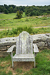 Lyme farmers market. Stone wall with antique and weathered Adirondack chair.