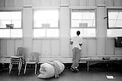 .An inmate takes a last glimpse out the window during inmate processing at Polk Youth Institution, where he received a mattress, towel and bunk.