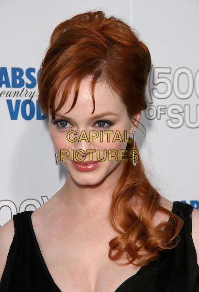 """CHRISTINA HENDRICKS.The Fox Searchlight L.A. Premiere of """"(500) Days of Summer"""" held at The Egyptian Theatre Theatre in Hollywood, California, USA. .June 24th, 2009.headshot portrait black .CAP/DVS.©Debbie VanStory/Capital Pictures."""