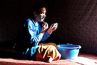 A man shaves in the Saharawi refugee camps on December 12, 2003. Saharawi people have been living at the refugee camps of the Algerian desert named Hamada, or desert of the deserts, for more than 30 years now. Saharawi people have suffered the consecuences of European colonialism and the war against occupation by Moroccan forces. Polisario and Moroccan Army are in conflict since 1975 when Hassan II, Moroccan King in 1975, sent more than 250.000 civilians and soldiers to colonize the Western Sahara when Spain left the country. Since 1991 they are in a peace process without any outcome so far. (Ander Gillenea / Bostok Photo)