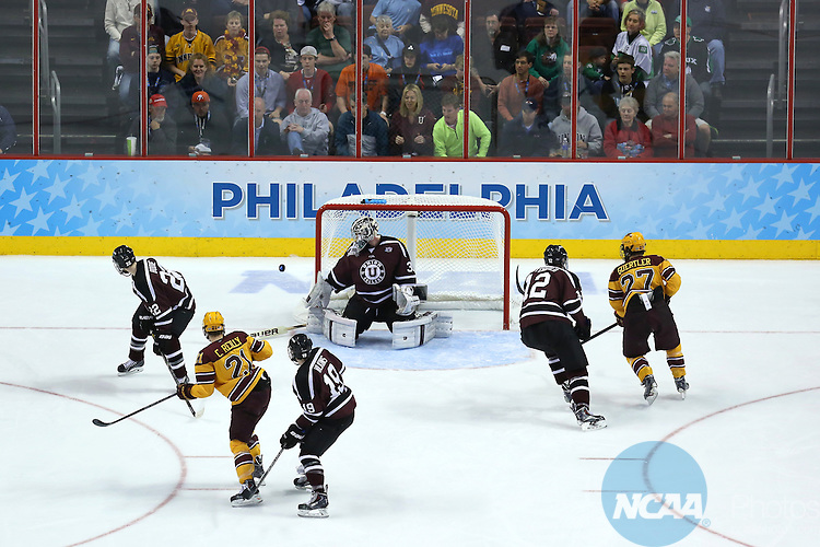 12 APR 2014:  Goalie Colin Stevens (30) of Union College makes a save against the University of Minnesota during the Division I Men's Ice Hockey Championship held at the Wells Fargo Center in Philadelphia, PA.  Union defeated Minnesota 7-4 for the national title.  Bill Streicher/NCAA Photos