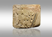 Landscape picture of Alaca Hoyuk Sphinx Gate Hittite monumental relief sculpted orthostat stone panel. Andesite, Alaca, Corum, 1399 - 1301 B.C. Jugglers and acrobats.  Anatolian Civilizations Museum, Ankara, Turkey<br /> <br /> The juggler facing towards left, with long hair and a short dress, swallows a dagger; the smaller acrobats behind go up the stairs without holding on. All the figures have horned headdresses and earrings with a huge ring on their ears. It is thought that the acrobats are of different nationality, which is the reason why they are depicted smaller. <br /> <br /> Against a brown gray background.