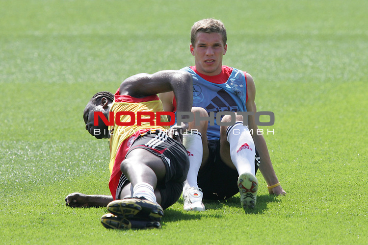 FIFA WM 2006 - Training - Germany<br /> Gerald Asamoah and Lukas Podolski (l-r) during a training session at the World Cup in Berlin (Stadion Wurfplatz). <br /> Foto &copy; nordphoto