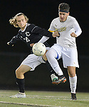 Trinity player Tyler Schonhoff (left) fights for possession of the ball with Bayless player Mervin Morales. They competed in a first-round game of the 64th Annual Bob Guelker/CYC Soccer Tournament at Columbia High School in Columbia, Illinois on Monday September 24, 2018.