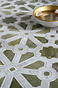 Jardin, a stone waterjet mosaic, shown in polished Verde Luna, Calacatta, and Carrara, is part of the Parterre Collection by Paul Schatz for New Ravenna.
