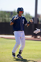 San Diego Padres second baseman Luis Almanzar (14) is congratulated after scoring a run during an Instructional League game against the Milwaukee Brewers on September 27, 2017 at Peoria Sports Complex in Peoria, Arizona. (Zachary Lucy/Four Seam Images)