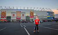 A young fan plays outside the ground ahead of the FIFA World Cup Qualifying match between Wales and Serbia at the Cardiff City Stadium, Cardiff, Wales on 12 November 2016. Photo by Mark  Hawkins.