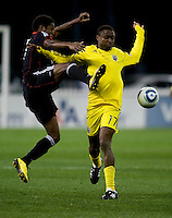 Clyde Simms (19) of D.C. United fights for the ball with Emmanuel Ekpo (17) of the Columbus Crew during the home opener at RFK Stadium in Washington D.C.  D.C. United defeated the Columbus Crew, 3-1.