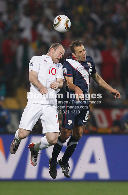 RUSTENBURG, SOUTH AFRICA - JUNE 12:  Wayne Rooney of England (l) and Steve Cherundolo of the United States (r) vie for a header during a 2010 FIFA World Cup soccer match June 12, 2010 in Rustenburg, South Africa.  NO mobile use.  Editorial ONLY.  (Photograph by Jonathan P. Larsen)