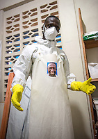 Occidental College professor Mary Beth Heffernan works on her PPE Portrait Project with health care workers at the ELWA II ETU (Ebola treatment unit) in Monrovia, Liberia on Tuesday, March 3, 2015. The ETU, operated by ELWA Hospital, was the first to open in Monrovia. Professor Heffernan's project involves creating wearable portraits of health care workers who must wear PPE (personal protective equipment) when working with patients, for example, patients with Ebola. <br /> (Photo by Marc Campos, Occidental College Photographer) Mary Beth Heffernan, professor of art and art history at Occidental College, works in Monrovia the capital of Liberia, Africa in 2015. Professor Heffernan was there to work on her PPE (personal protective equipment) Portrait Project, which helps health care workers and patients fighting the Ebola virus disease in West Africa.<br />