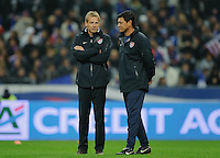 Jurgen Klinsmann, coach of team USA, and assistant coach Martin Vasquez chat prior to the friendly match France against USA at the Stade de France in Paris, France on November 11th, 2011.