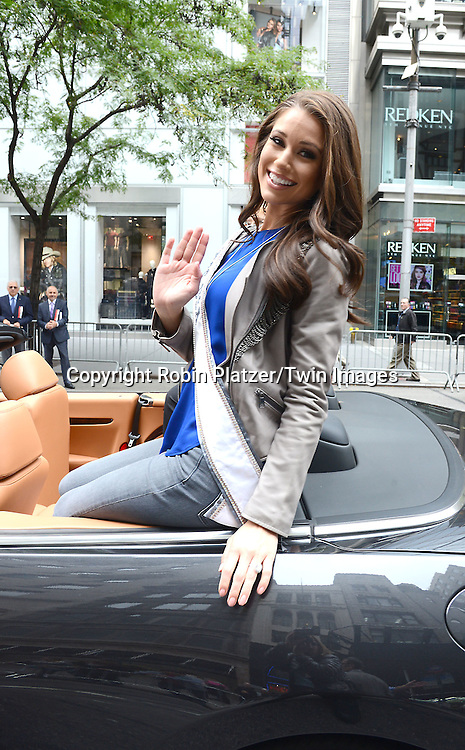 Miss USA Nia Sanchez marchs in the 70th Annual Columbus Day Parade on October 13, 2014 on Fifth Avenue in New York City. <br /> <br /> photo by Robin Platzer/Twin Images<br />  <br /> phone number 212-935-0770