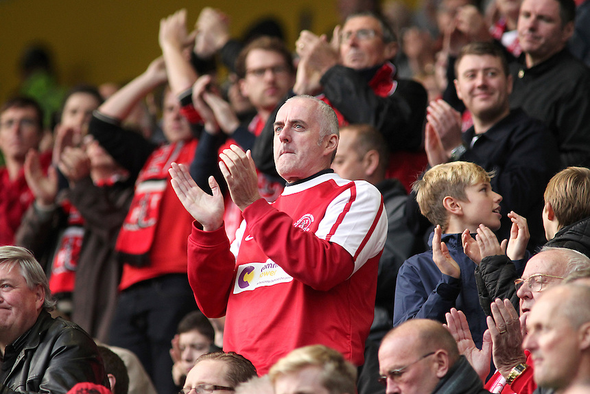 Fleetwood Town fans applaud their sides performance during the match<br /> <br /> Photographer Rich Linley/CameraSport<br /> <br /> Football - The Football League Sky Bet League One - Preston North End v Fleetwood Town - Saturday 25th October 2014 - Deepdale - Preston<br /> <br /> &copy; CameraSport - 43 Linden Ave. Countesthorpe. Leicester. England. LE8 5PG - Tel: +44 (0) 116 277 4147 - admin@camerasport.com - www.camerasport.com