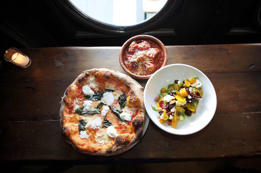 Jersey City, NJ - April 27, 2016: Pizza, Meatballs and Beet Salad at Razza Pizza Artigianale, a brick oven pizzeria by chef Dan Richer in Jersey City.<br /> <br /> CREDIT: Clay Williams for Gothamist<br /> <br /> &copy; Clay Williams / claywilliamsphoto.com