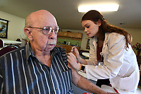 NWA Democrat-Gazette/J.T. WAMPLER Carl Smith of Fayetteville gets a flu shot from pharmacist Kara High Monday Nov. 13, 2017 during a free flu shot clinic at Wedington Place Apartments in Fayetteville. Walgreens on Wedington Drive sponsored the flu clinic for seniors at the complex.