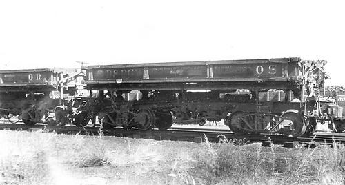 3/4 view of D&amp;RGW air dump car #OS at Gunnison.<br /> D&amp;RGW  Gunnison, CO  Taken by Ward, Bert H. - 7/1946