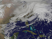 A massive winter storm is coming together as two low pressure systems are merging over the U.S. East Coast. A satellite image from NOAA's GOES-13 satellite on Feb. 8 shows a western frontal system approaching the coastal low pressure area. The satellite image, captured at 9:01 a.m. EST, shows clouds associated with the western frontal system stretching from Canada through the Ohio and Tennessee valleys, into the Gulf of Mexico. The comma-shaped low pressure system located over the Atlantic, east of Virginia, is forecast to merge with the front and create a powerful nor'easter. The National Weather Service expects the merged storm to move northeast and drop between two to three feet of snow in parts of New England. .Credit: NASA via CNP