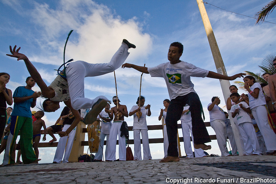 Roda de Capoeira, Young couple practicing capoeira at Ponta Negra beach, Natal city, Rio Grande do Norte State, Brazil. Afro-brazilian cultural traditions, mix of fight and dance.