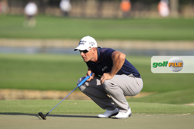 Henrik Stenson (SWE) on the 14th green during Thursday's Round 1 of the Omega Dubai Desert Classic 2014 held at the Emirates Golf Club, Dubai. 30th January 2014.<br /> Picture: Eoin Clarke www.golffile.ie