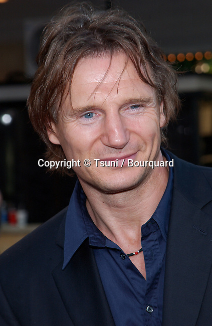 """Liam Neeson arriving at the premiere of """"K-19: The Widowmaker"""" at the Westwood Theatre in Los Angeles. July 15, 2002."""