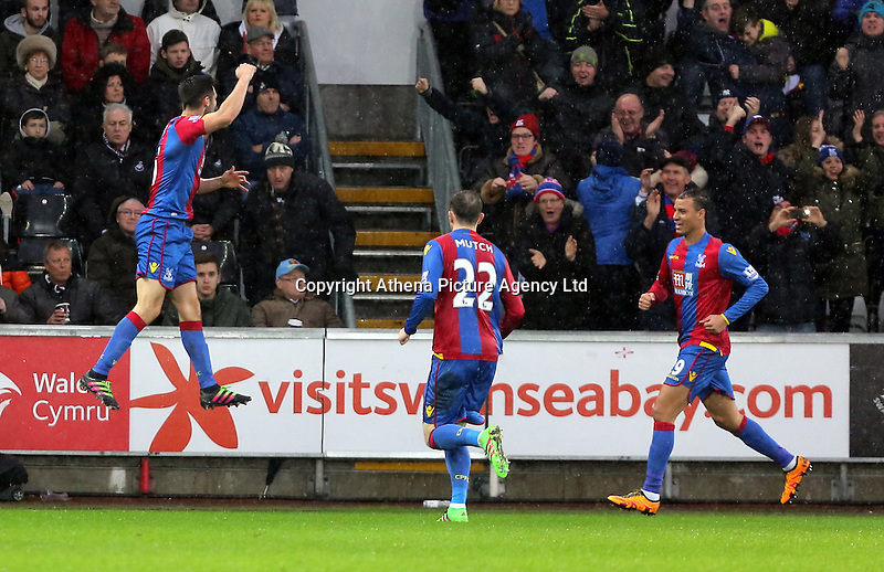 Scott Dann of Crystal Palace (L) celebrates his equaliser during the Barclays Premier League match between Swansea City and Crystal Palace at the Liberty Stadium, Swansea on February 06 2016