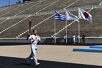 19th March 2020, Athens, Greece; The Olympic Flame, lit on Mount Olympia, is handed over officially to the  congregation from Japan, to be taken to Tokyo for the 2020 Olympic Games in July 2020. Greek Olympic medalist in artistic gymnastics EleftheriPetrounias holds the Tokyo Olympic Flame at the Panathenaic stadium, in Athens