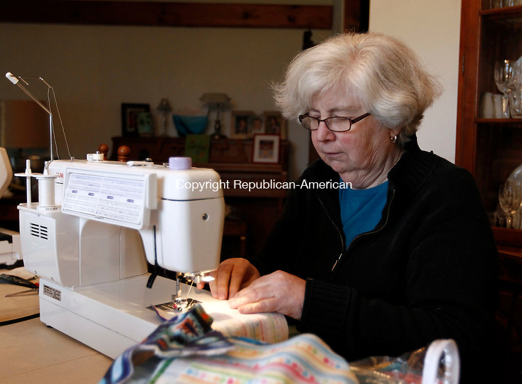 Bethlehem, CT- 01 April 2014-043014CM12  Elaine Brodeur, member of the 4-H sewing club of Bethlehem runs fabric through a Janome sewing machine at her residence in Bethlehem on Wednesday.  The inception of the group dates back to 1955.   Christopher Massa Republican-American