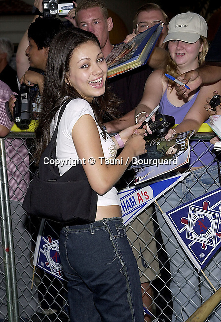 Mila Kunis arriving at the premiere of Summer Catch at the Mann Village Theatre in Los Angeles. August 22, 2001. © Tsuni          -            KunisMila03.jpg