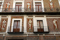 Facade of the Casa de las Munecos or House of the Dolls in the city of Puebla, Mexico. The historical center of Puebla is a UNESCO World Heritage Site..