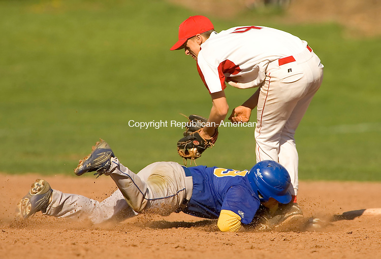 WOLCOTT, CT--02 MAY 2007--050207JS02- Seymour's Jack Smith (29) is called out after getting tagged by Wolcott's Ryan Pelletier (4) during their game Wednesday at the BAW field in Wolcott. <br /> Jim Shannon/Republican-American