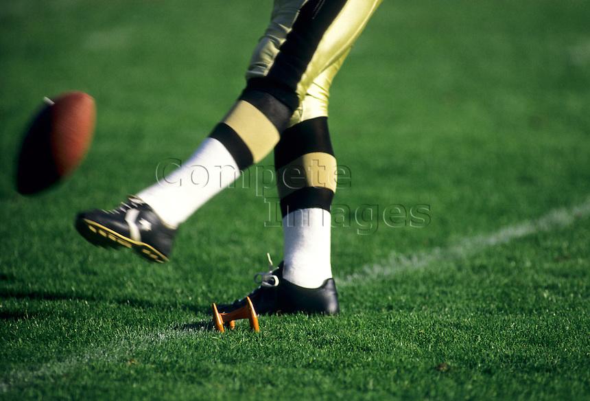 American Football kicker kicks off to start a game.